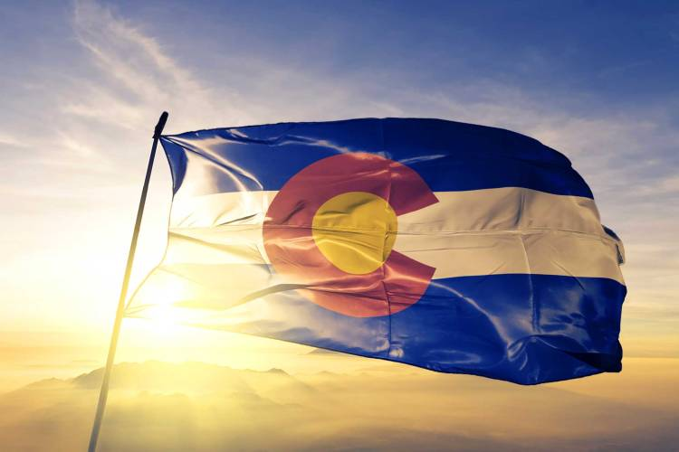 Colorado Flag against a sunset